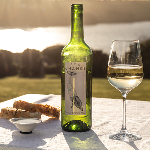 White Wine bottle with glass and food