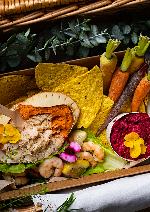 Picnic Basket with crab seafood and carrots inside